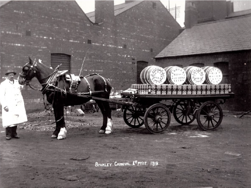 An old black and white photograph of an H Foster horse-drawn wagon.