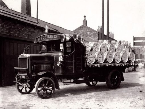 Black and white photograph of H Foster wagon with barrels on the back.