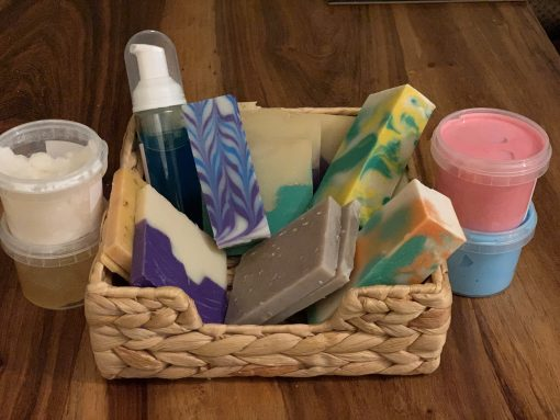 A wicker basket with homemade loaves of soap.