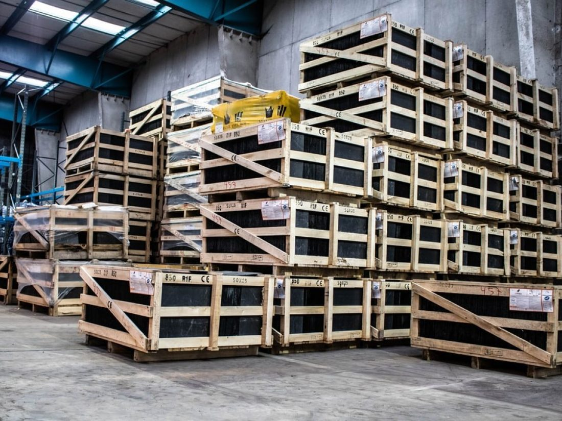 Wooden pallets stacked up in a warehouse.