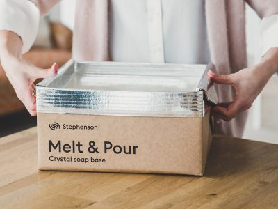 Melt and pour soap base being removed from plastic-free packaging.